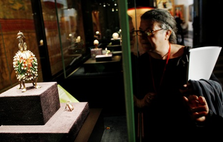 A woman looks at the Lilies of the Valley Egg at the exhibition