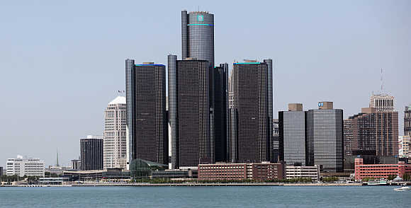 The city of Detroit skyline, including General Motors Global Headquarters, is seen along the Detroit River from Windsor, Canada.