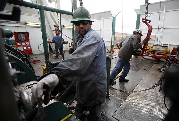 Mike Wipf operates the drill on a True Company oil drilling rig outside Watford, North Dakota.