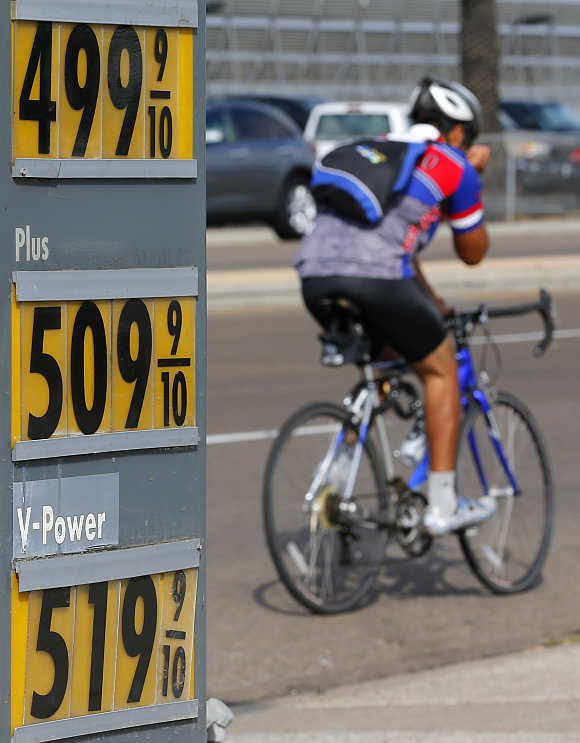 A cyclists rides past a gas station in San Diego, California.