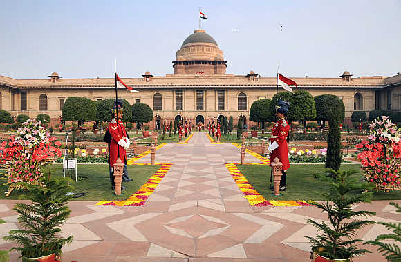 Guards stand in Mughal gardens surrounding Rashtrapati Bhavan in New Delhi.