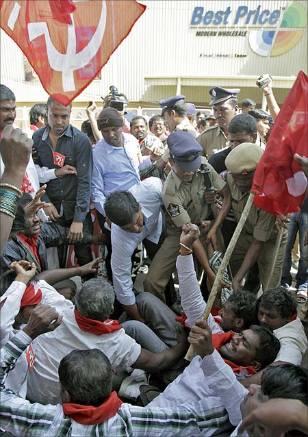 Police detain supporters of Communist Party of India protesting against foreign direct investment in retail, in front of the Bharti Walmart Best Price Modern wholesale store in Hyderabad.