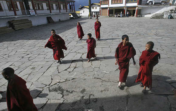 Child monks walk to attend morning prayers in Arunachal Pradesh.
