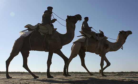 Indian Border Security Force personnel patrol at the white desert of the Rann of Kutch, Gujarat.