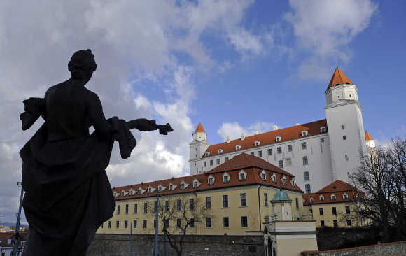 The 'Welcome' statue is seen in front of Bratislava castle in Bratislava.