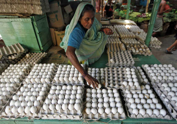 A vendor arranges eggs for sale at a market in Kolkata.