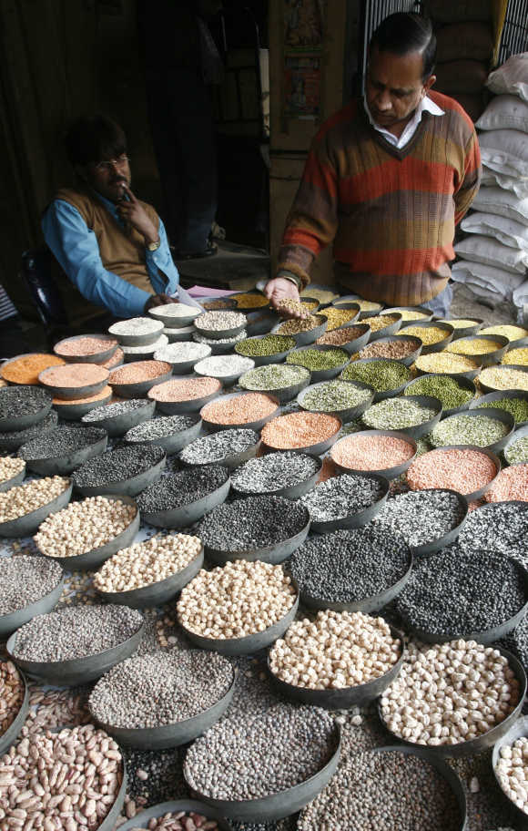 A customer checks pulses at a wholesale market in old quarters of Delhi.