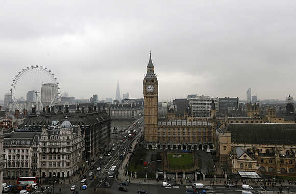 Houses of Parliament and the London Eye are seen in central London, United Kingdom.
