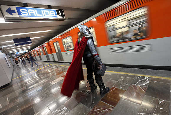 Ruben Oviedo, 40, dressed as comics superhero Thor, waits for the subway in Mexico City, Mexico.