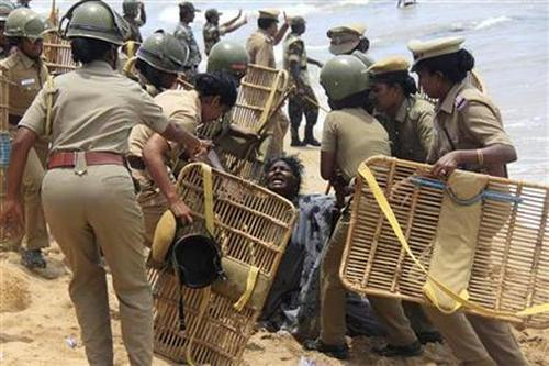 Police detain a demonstrator during a protest near a nuclear power project in Kudankulam in Tamil Nadu.