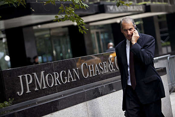 A man walks past JP Morgan Chase's international headquarters on Park Avenue in New York.