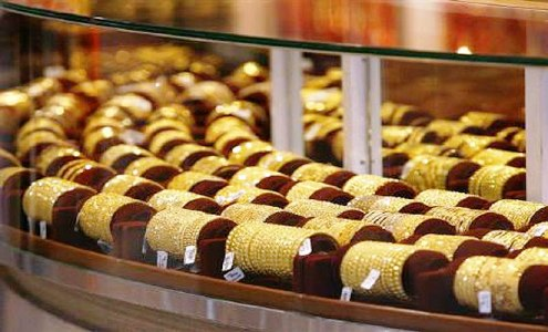 Gold ornaments displayed in a jewellery store.