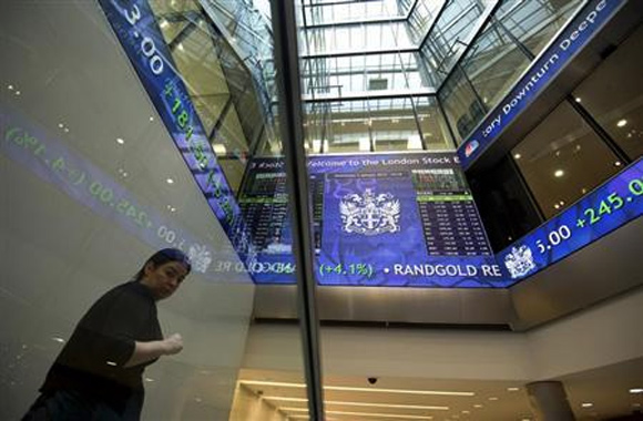 Electronic information boards display market information at the London Stock Exchange, in London.