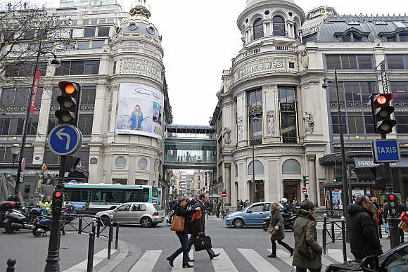 People walk past the Printemps department store in Paris.