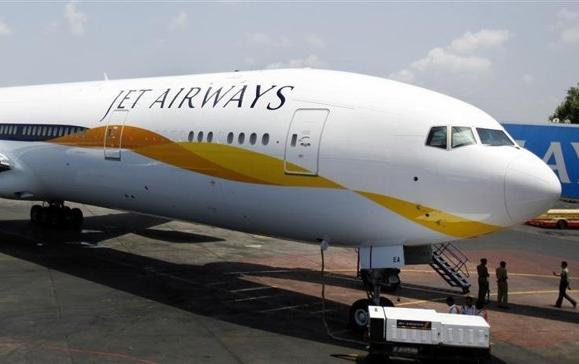 A newly acquired Jet Airways Boeing 777-300ER aircraft sits on the tarmac at Mumbai airport.