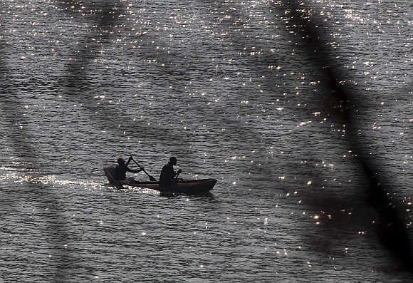Local fishermen row their traditional canoe at Cahora Bassa dam in Tete province, Mozambique.