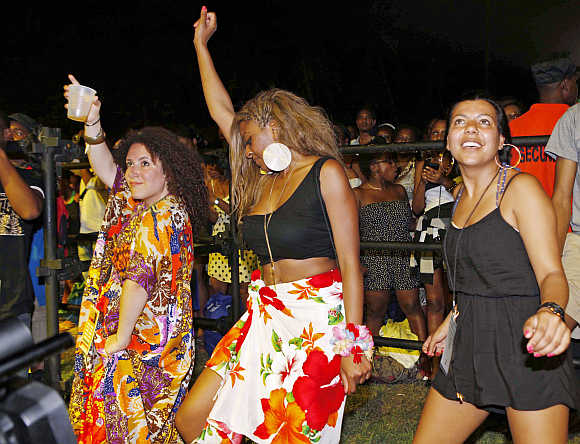Music fans dance during the final day of the St Lucia Jazz Festival at Pigeon Island in St Lucia.