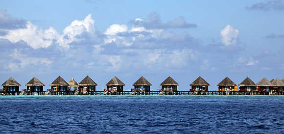 Tourist huts on a reef at a resort island in Male, Maldives.