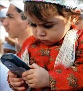 A child plays with a mobile