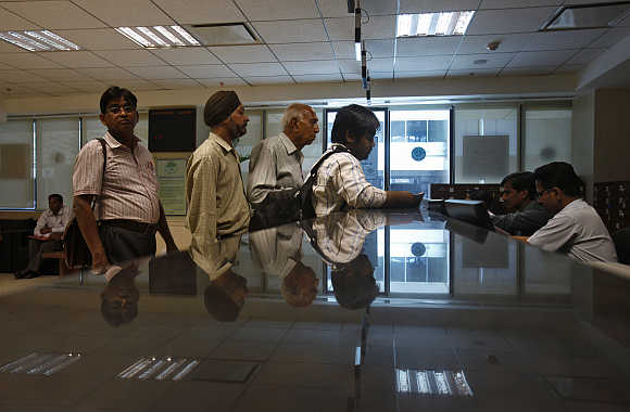 People submit their papers inside the Income Tax office in New Delhi.
