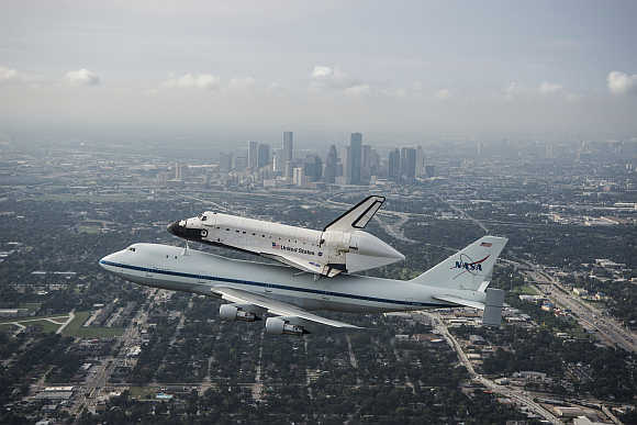 Space shuttle Endeavour, atop Nasa's Shuttle Carrier Aircraft, flies over Houston, Texas.