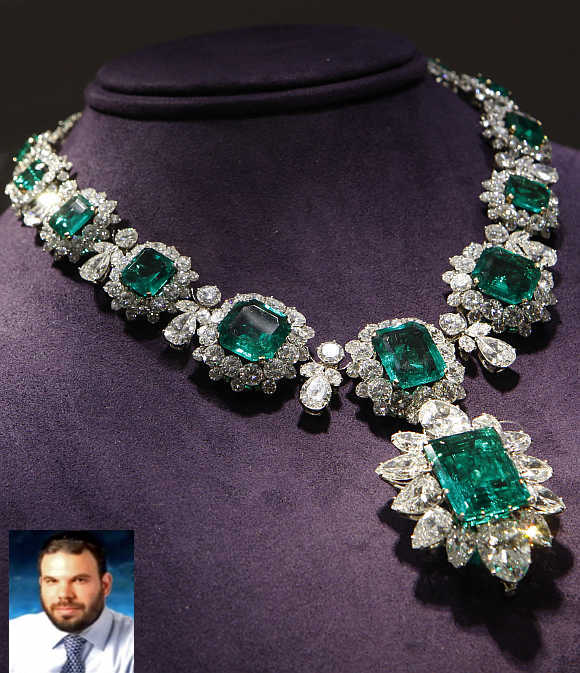 An emerald and diamond pendant and necklace by Bvlgari priced between $2.5 million to $3.5 million, which was a gift from Richard Burton to Elizabeth Taylor, on display in New York City. Inset, Dan Gertler.