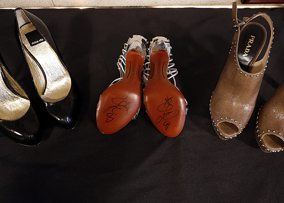 Pairs of Carrie Bradshaw's shoes are displayed at Gotta Have it! auction house in New York auction house in New York.