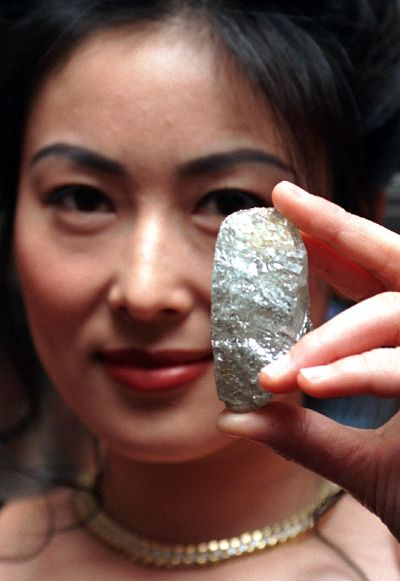 A model displays the Sefadu diamond, the world's largest uncut diamond in existence today.
