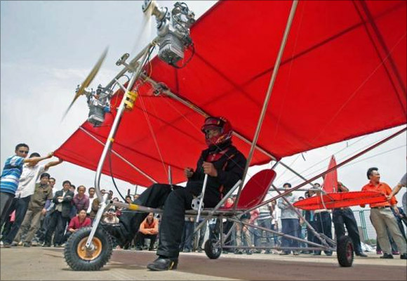 Farmer Shu Mansheng prepares to take off with his homemade ultralight aircraft in Wuhan, Hubei province, China.
