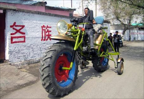 An ethnic Uighur man Abulajon drives his self-made motorcycle during a test in Manas county, Xinjiang Uighur autonomous region.