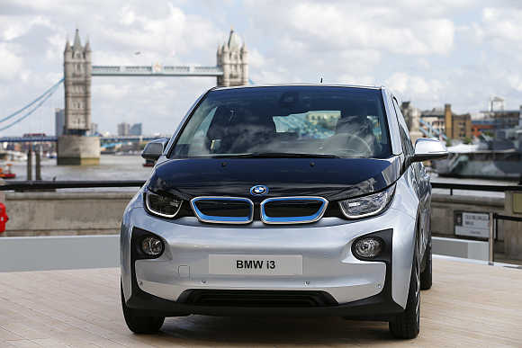 BMW i3 electric car with Tower Bridge behind it in London.