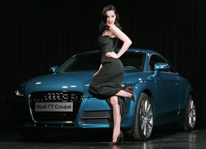 Burlesque artiste Dita von Teese of the US poses in front of the new model Audi TT car during its UK launch in London.