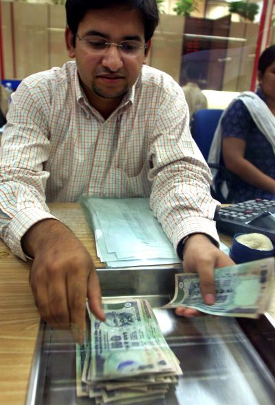 Rupee crashes, government says no need to panic