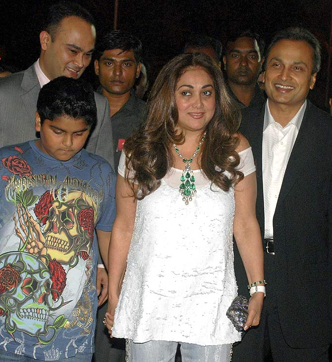 Anil Ambani (R), chairman of Anil Dhirubhai Ambani group, his wife Tina (C) in Mumbai.