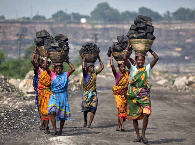 Women carry coal taken from an open cast coal field in Dhanbad district, Jharkhand.