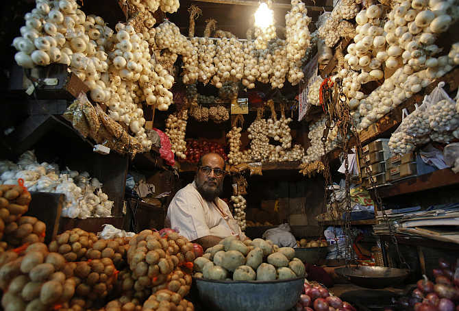 A vendor waits for customers at his stall at a wholesale food market in Mumbai.