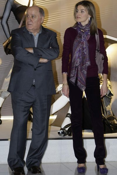 Spain's Princess Letizia (R) stands next to chairman of Spanish global fashion giant Inditex, Amancio Ortega, during a visit to an Inditex factory in Coruna, northern Spain.