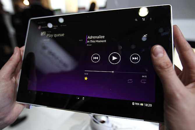 A visitor holds Sony Xperia Z tablet during the Mobile World Congress in Barcelona, Spain.
