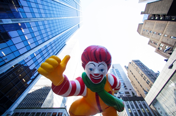A Ronald McDonald balloon floats down Sixth Avenue during the 87th Macy's Thanksgiving Day Parade in New York, November 28, 2013.