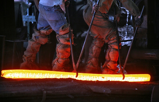 Labourers work inside an iron factory on the outskirts of Jammu.