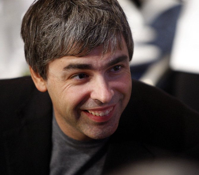 Google co-founder Larry Page speaks with people at his lunch table during the Clinton Global Initiative in New York.