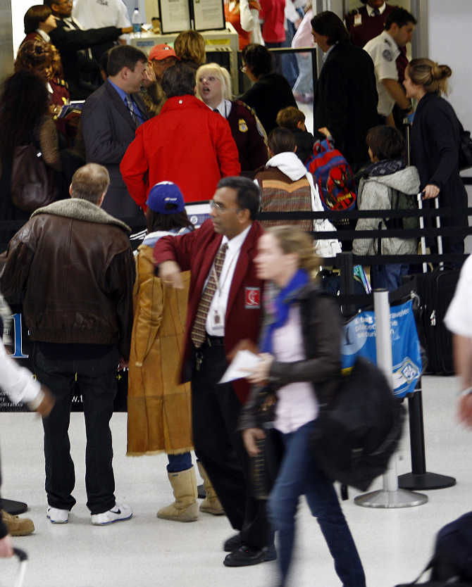 Travellers make their way through Newark's Liberty International Airport in Newark, New Jersey.