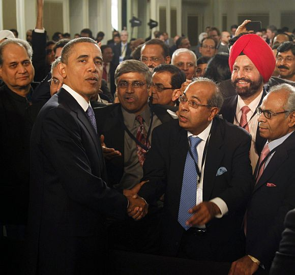 US President Barack Obama meets members of the audience after delivering remarks at the US-India business council and entrepreneurship summit in Mumbai.