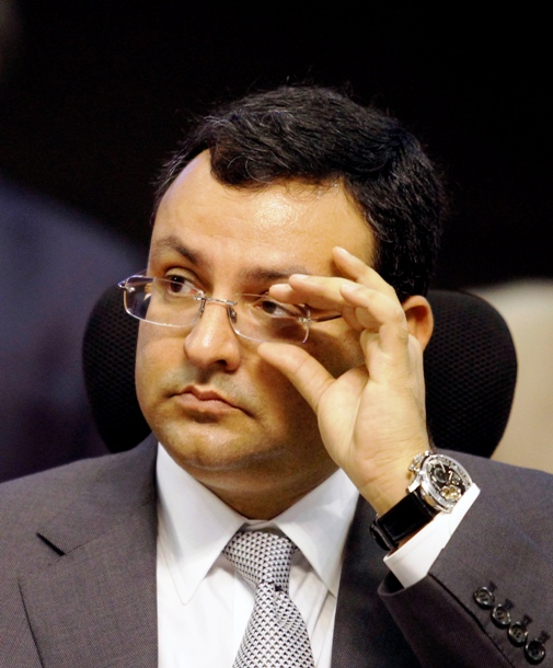 Tata Group chairman Cyrus Mistry adjusts his glasses as he attends the Vibrant Gujarat Summit at Gandhinagar.