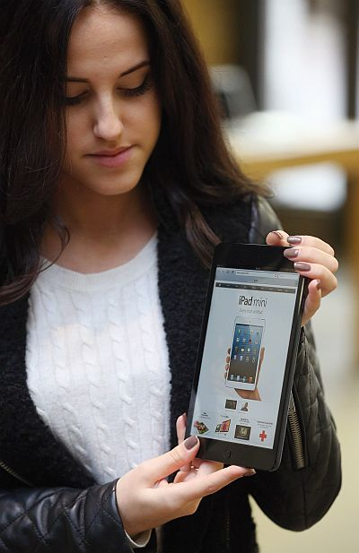 A woman holds a new 'iPad mini' on the morning of the tablet's launch in the Apple Store in Covent Garden, London.