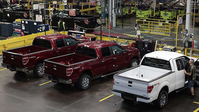 2014 Ford F-150 pick-up trucks are seen in quality control at the Ford Motor Dearborn Truck Plant in Dearborn, Michigan.