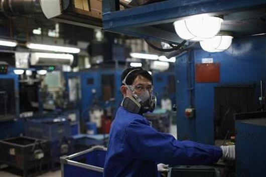 A labour in a manufacturing plant in China.