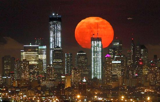 The moon rises over the skyline of Manhattan in New York - the city used as a base for the survey.