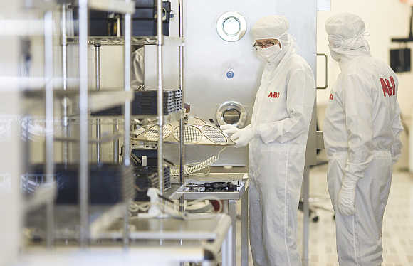 Employees work on the production of high-power semiconductors at a manufacturing plant of Swiss engineering group ABB in Lenzburg. Photo is for representation purpose only.