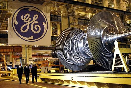 US President Barack Obama (C) passes a turbine as he tours General Electric's birthplace in Schenectady, New York.